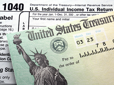 Photo of Form 1040 and Tax Refund Check